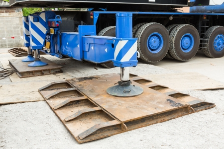 outrigger: Heavy duty steel crane outrigger pad in construction site Stock Photo
