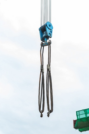 Heavy duty steel wire rope sling with safety anchor shackle bolt on crane hook photo
