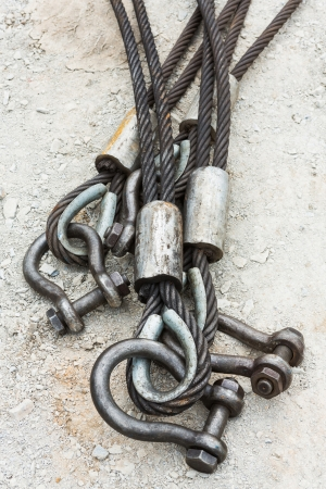 Heavy duty steel wire rope sling with safety anchor shackle bolt in construction site photo