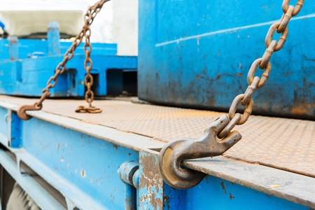 hook up: Close up rusty heavy duty hook and chain wire rope