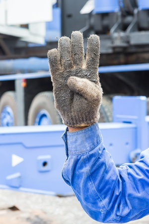 Worker show his 4 finger in grunge cloth glove mean number four photo