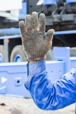 Worker show his five fingers in grunge cloth glove mean number 5 photo