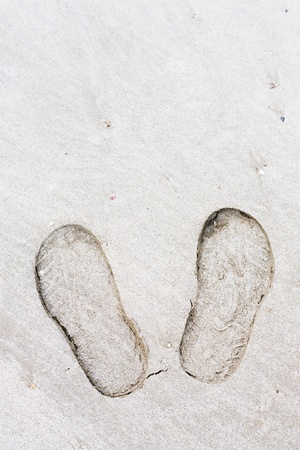 Close up shoe prints in the beach photo