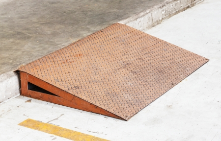 Grunge diamond steel plate ramp in car garage photo