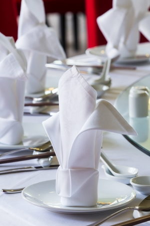 Close up white napkin on chinese dining table set up photo