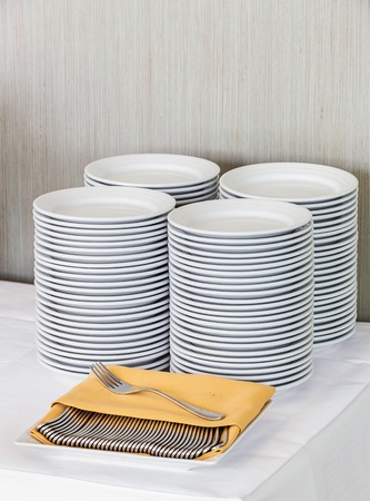 Close up stacks of white color dishes for party time Stock Photo