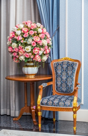 ferns and orchids: Elegance armchair with beautiful flower bouquet in luxury house