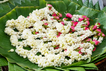Close up small jasmine garland on banana leaves  photo