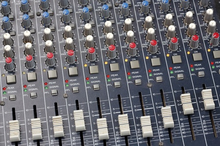 Close up multi color buttons of sound mixer console photo