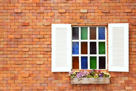 White windows on red color brick wall photo