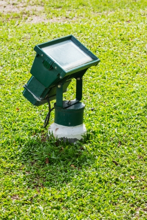 Close up green color garden flood light in lawn photo