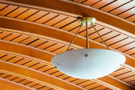 Close up elegant ceiling lamp in old wooden home photo