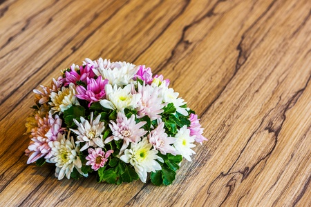 aralia: Close up flower bouquet on wood table