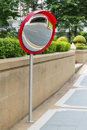 convex: Close up traffic convex mirror near car park entrance