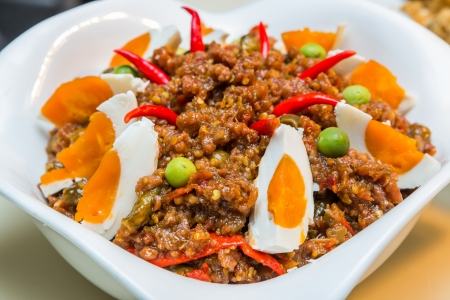 Close up spicy shrimp paste and minced pork served with salted duck egg photo