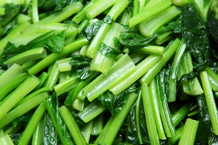 stir up: Close up stir fried chinese mustard greens