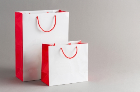 Big and small paper shopping bag isolated on gray background photo