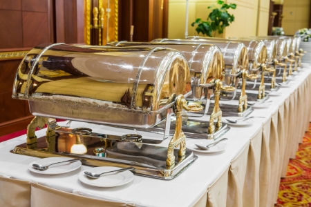 heated: Close up luxury warming trays for buffet line Stock Photo