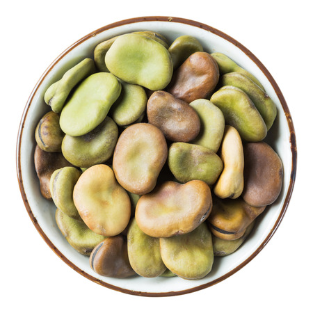 Close up fava bean in ceramic dish isolated on white - with path photo