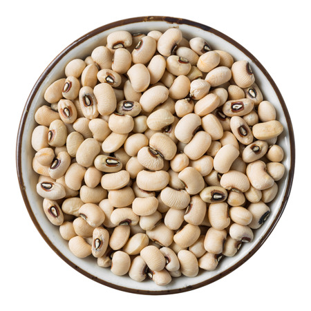 Close up white bean in ceramic dish isolated on white - with path photo