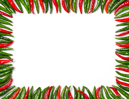 Close up rectangular frame arrange from red and green bird chili isolated on white Фото со стока