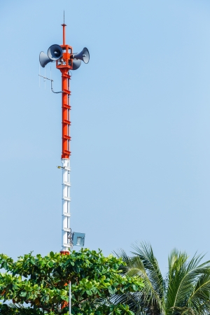 Outdoor speaker and spotlight on steel pole in public park photo