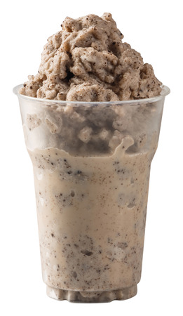 Close up dark chocolate flavored cookie smoothie in plastic cup isolated on white - with path photo