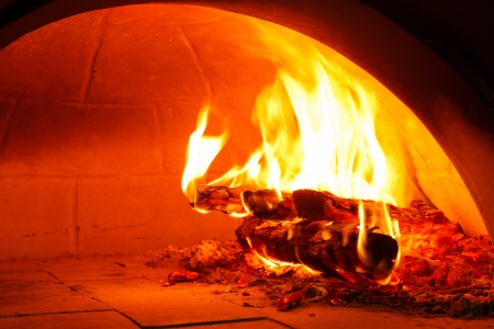 wood burning stove: Close up firewood oven with flame ready for bake pizza Stock Photo