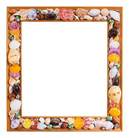 Close up photo frame decorated with colorful seashell isolated on white with path photo