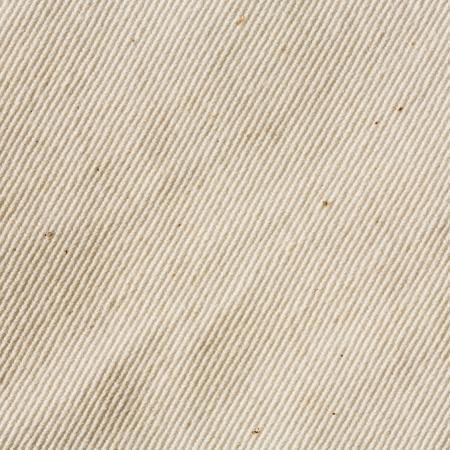 cream colour: Primo piano colore crema mussola greggi texture di tessuto