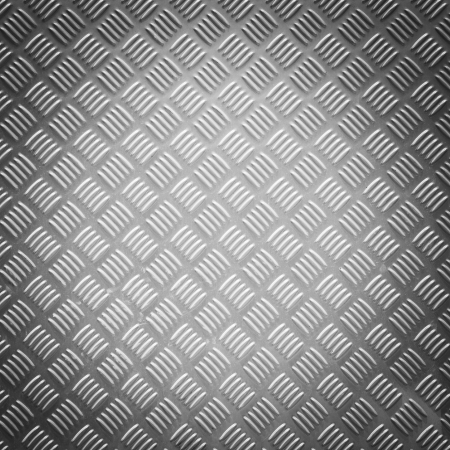 Close up vignette style diamond steel plate texture photo