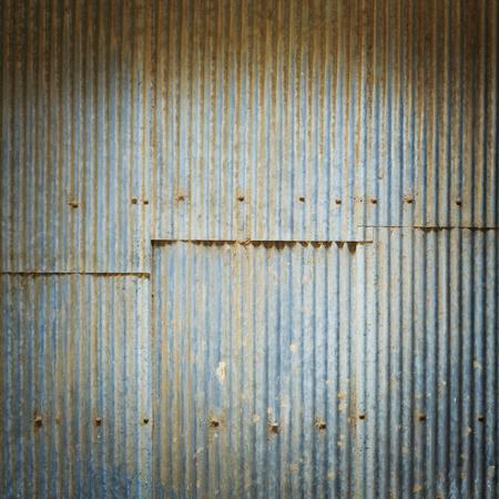 Vignette style grunge corrugated zinc sheet texture background photo