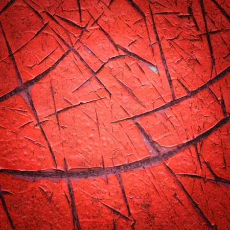 Close up vignette style red color cracked paint texture photo