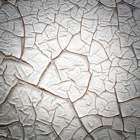 Close up white color Vignette style cracked paint texture photo