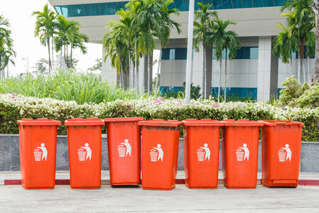 waste management: Orange color plastic bin for waste management outside of the building Stock Photo