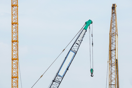 Cranes in construction site with blue sky background photo
