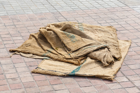 gunny: Close up old and dirty sacks on concrete floor Stock Photo