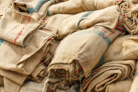 gunny bag: Close up old and dirty sacks on concrete floor Stock Photo