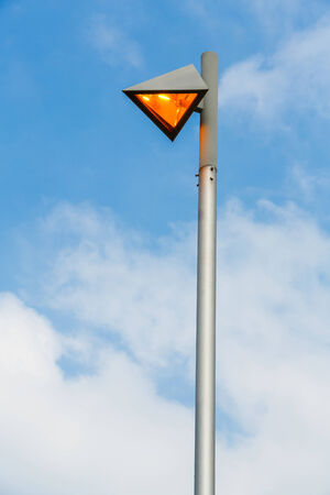 Modern street lamp on blue sky in the evening photo