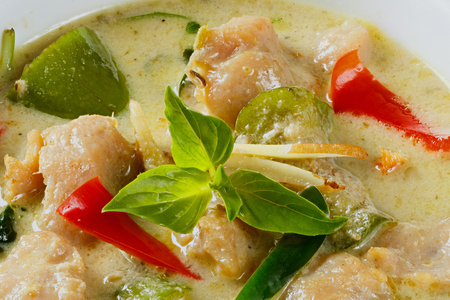 Close up clown knifefish ball green curry with sweet basil and chili - deep focus image photo
