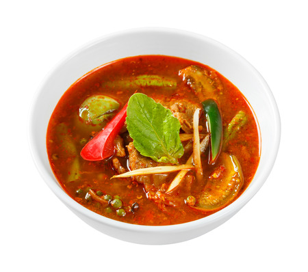 egg plant: Close up spicy red curry with pork fingerroot basil egg plant pepper and chili without coconut milk - with path Stock Photo