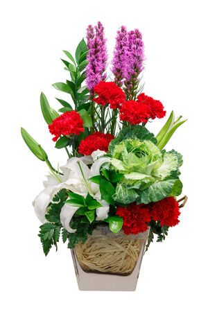 Close up bouquet of lily cabbage and red carnation flower in glass vase isolated on white photo