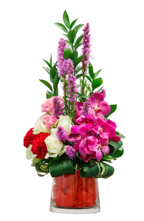 Close up bouquet of orchid rose and carnation flowers in glass vase isolated on white photo
