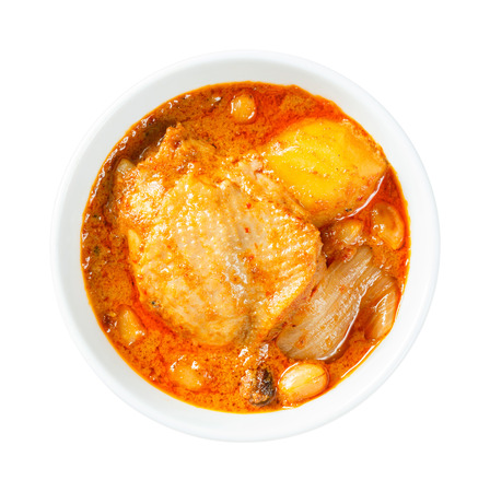 Close up Muslim style chicken and potato curry or chicken mussaman curry photo