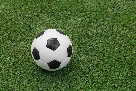 Close up soccer ball on green grass or artificial turf photo