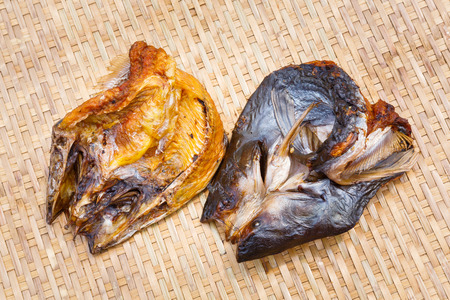 Close up Crispy smoke dried mystus nemurus catfish on bamboo threshing basket