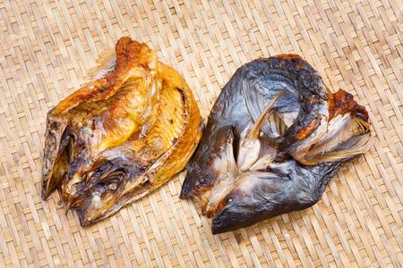 Close up Crispy smoke dried mystus nemurus catfish on bamboo threshing basket Stock Photo - 27593796