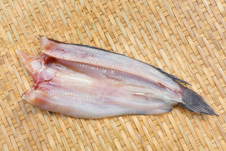 common snakehead: Thai traditional dried striped snakehead fish on bamboo threshing basket Stock Photo