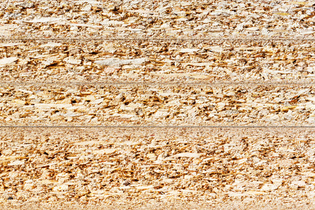 Close up cross section texture of particle board stacks Фото со стока