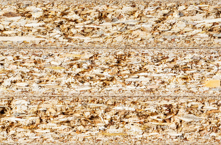 Close up cross section texture of particle board stacks photo
